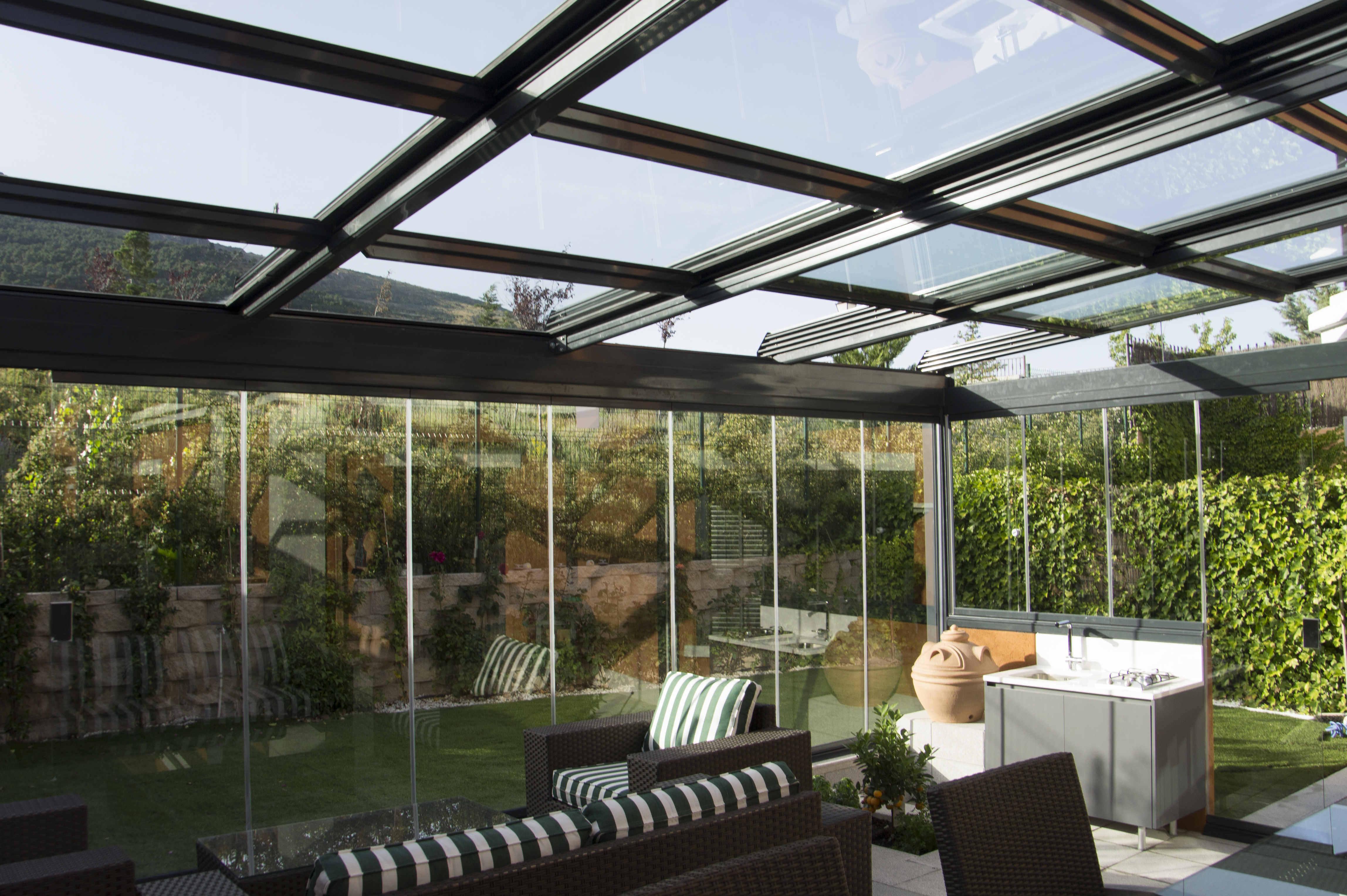 Fraimar aluminios s l techos cortinas de cristal y for Bajos con jardin en pozuelo